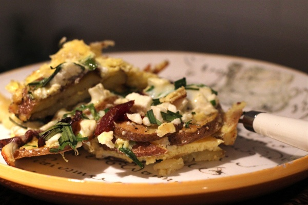 Frittata with bacon, potatoes, feta and scallions. Made this tonight ...