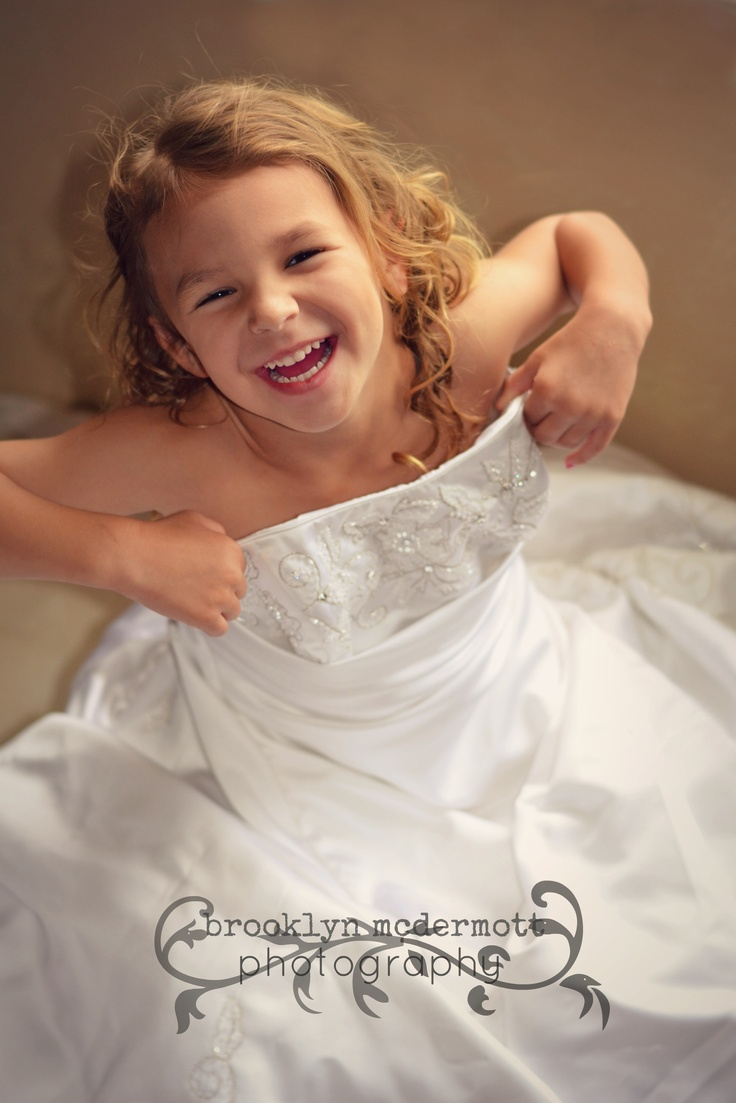 daughter in moms wedding dress fun family pictures