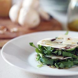 salad with raw mushroom, roasted pine nuts, rocket, slices of Parmesan ...