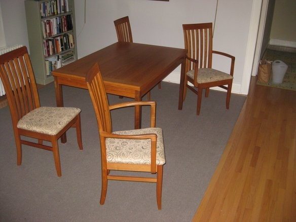 teak expanding dining room table and 4 chairs