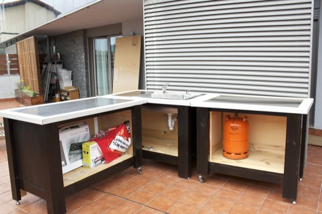 outdoor kitchen in progress using ikea components not sure how well