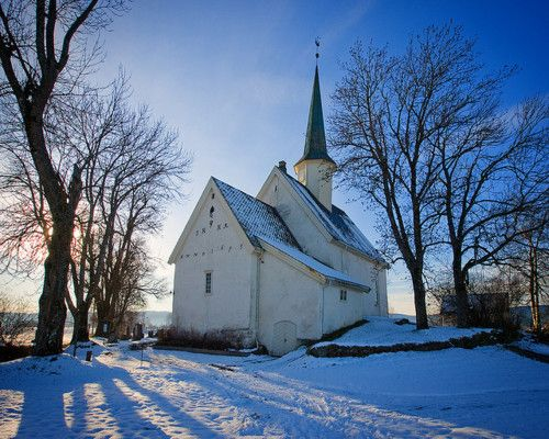 An old white church against the snow.  So beautiful in its simplicity.