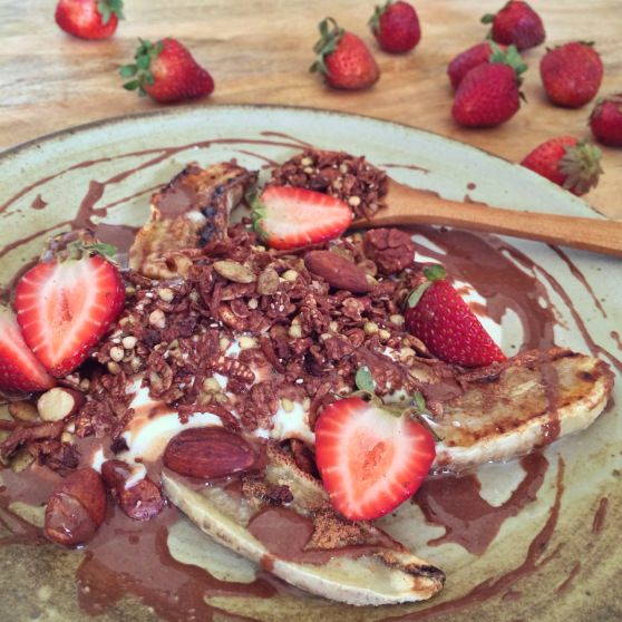 ... toasted coconut flakes and a choc-peanut butter sauce. Top with fresh