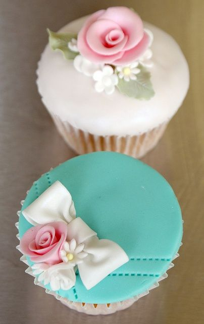 beautiful decorated cup cakes with teal blue and pink roses