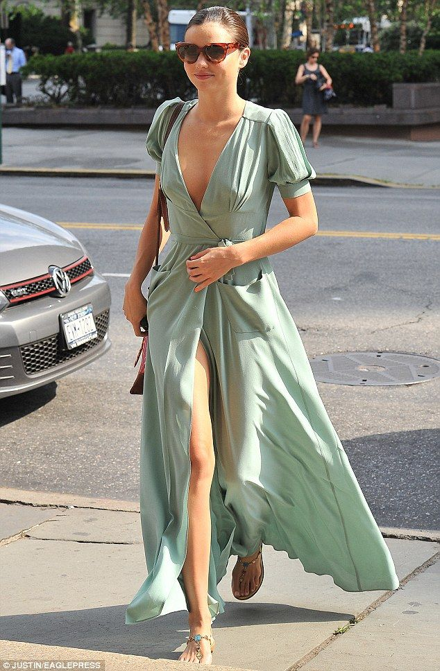 Leggy lady! Miranda Kerr stepped out in New York today in a mint green maxi dress with both a plunging neckline and hip-high slit