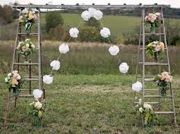 i dont like the white flowers but we like the Π shaped wooden arch and the fact that it is a bit different. Different is good!