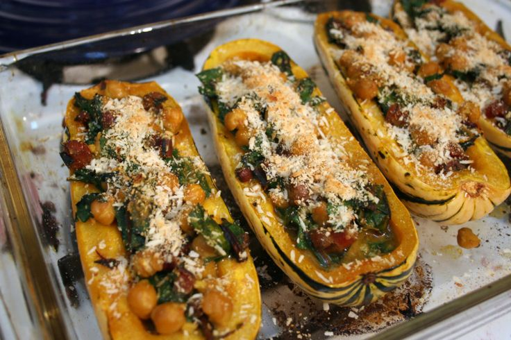 Delicata Squash stuffed with Coconut Curry Swiss Chard and Chickpeas.