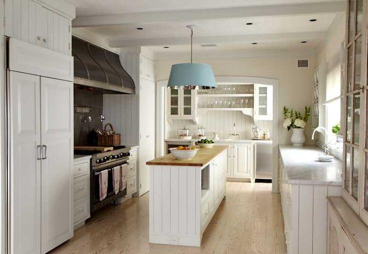 ... kitchen, butcher block island. Professional range and huge hood. Aqua