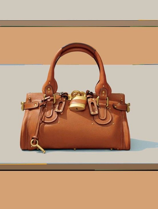 Forever a classic.   http://www.barneys.com/Chlo%C3%A9-Large-Paddington-Satchel/00505025249767,default,pd.html?cgid=womens-shoulder=0