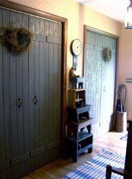 Bi-fold closet doors made to look like barn doors.