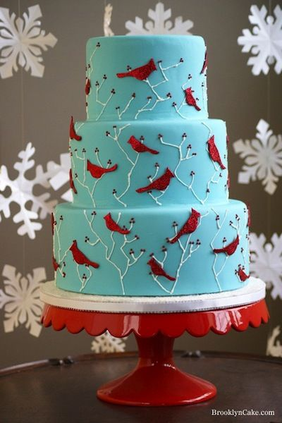 'Winter cakes don't have to be all white either, here's a very bright and cheery cake that uses red cardinals as its winter accent.'