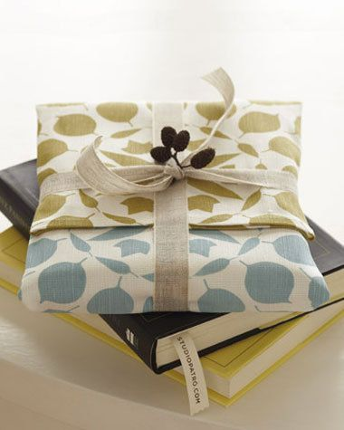 Wrapping idea- cookbooks wrapped in dish towels.