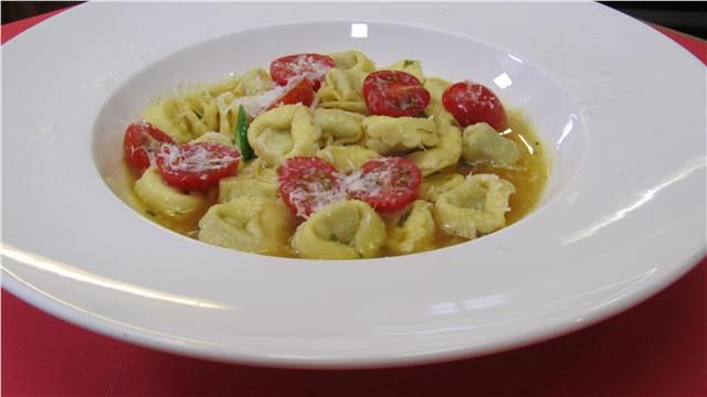 "Chicken tortellini ""in broth"" with asparagus, tomatoes and parmesan..."