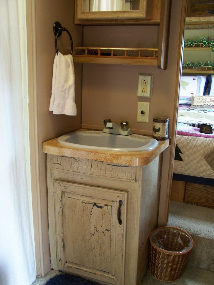 Camper remodel painted bath cabinet and counter top for for Travel trailer bathroom ideas