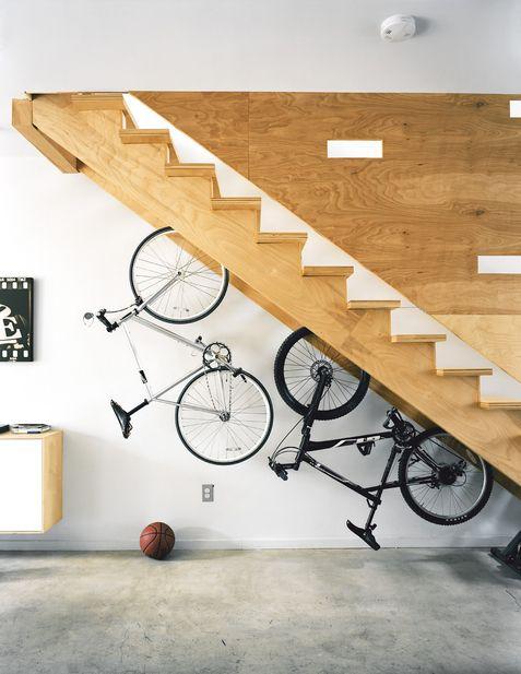 Bikes hung under stairs.