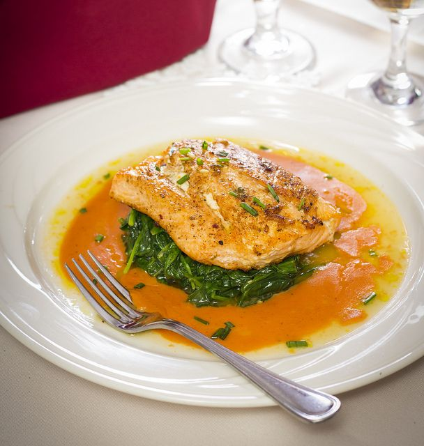 Pan-seared Salmon with Champagne Sauce served atop sautéed spinach ...