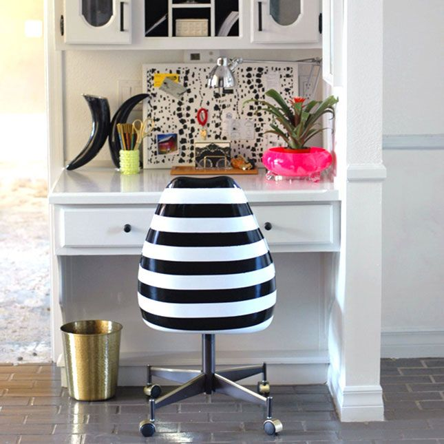 black and white pattern fabric pinboard, with black and white stripy chair, from 21 Super Chic Black & White DIYs via Brit + Co.