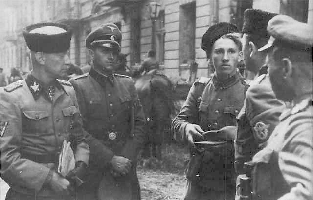 Waffen SS-group leader Heinz Reinefarth (on the left, with Cossack cap), general of police and Waffen-SS, with officers of Regiment III of the Cossacks of chief Jakub Bondarenko during the Warsaw Uprising near Wolska street. August 1944. Bondarenko was also colonel of the Infantry Regiment of Kuban Cossacks and fought on the side of the Germans throughout.