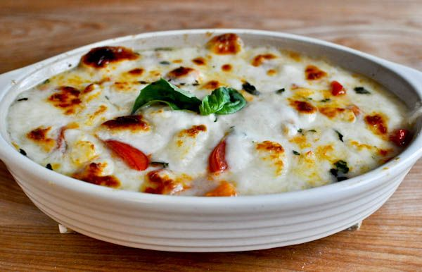 """hot caprese dip -- best line in the receipe: """"It will look like this. And then you might die. But that's okay, because having this as your final meal totally makes sense."""""""