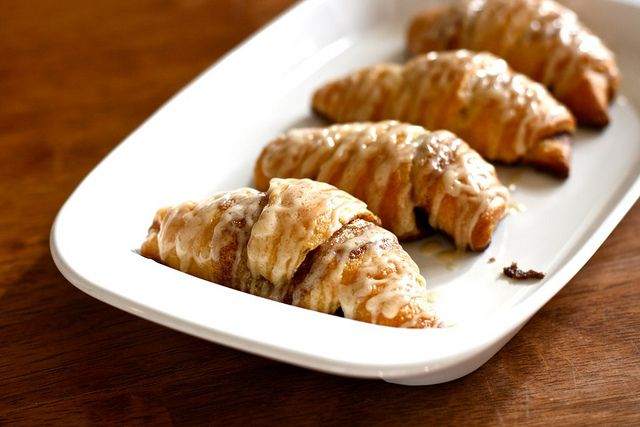 Unroll a crescent roll, spread a mixture of butter and cinnamon over it, roll it up, bake as directed on can. Drizzle with a glaze of 2T melted butter, 1/4 cup+2 T powdered sugar, and 1/2 teaspoon vanilla extract.  Enjoy.