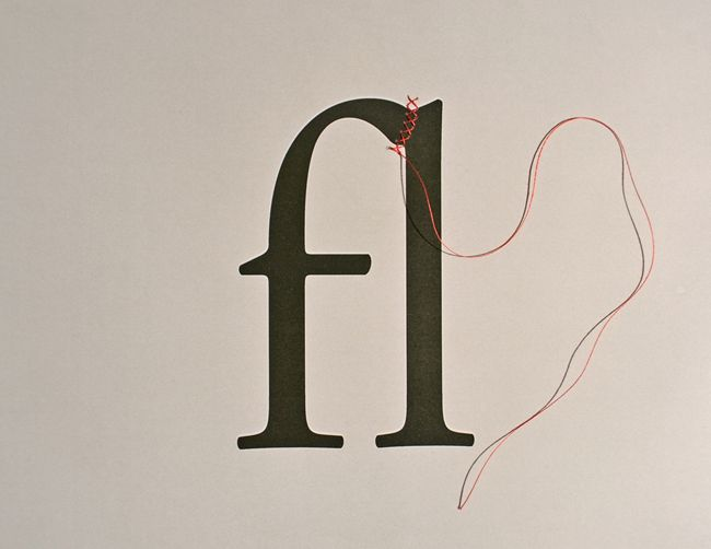 by David Schwen. Ligature that is threaded together.