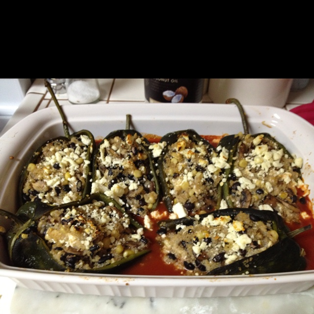Poblano chiles stuffed with corn, black beans and mushrooms topped ...