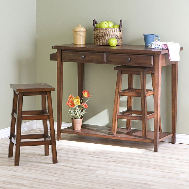 This table set includes hideaway stools to save space and side by side