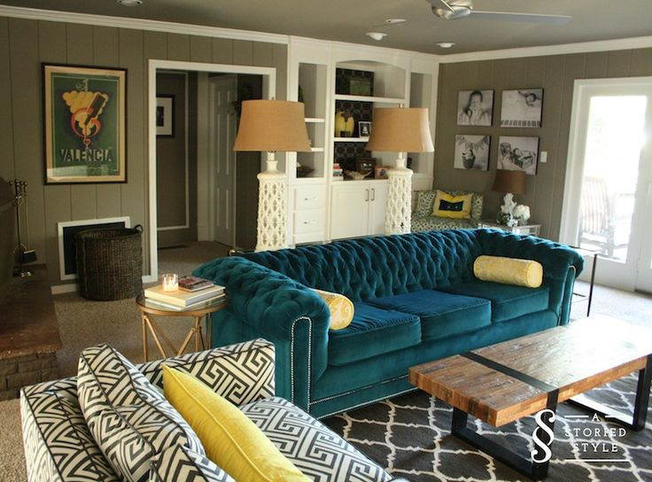 living room with a colorful teal sofa living room ideas