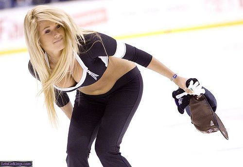 LA Kings Ice Girl Sara picks up hats after Anze Kopitar's first ever hat trick on Thursday night by Michael Zampelli, via Flickr