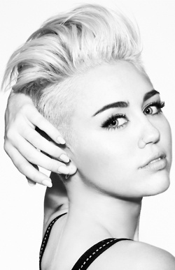 Miley Cyrus and her new hair duo | Gee....your hair looks terrific ...