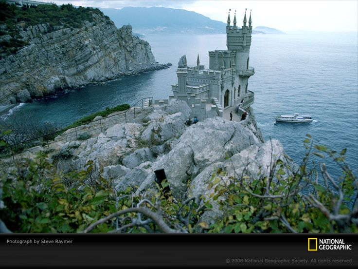 """Black Sea Castle, Yalta, Russia/Ukraine, 1987 The neo-Gothic Swallow's Nest castle perches 130 feet (40 meters) above the Black Sea near Yalta in southern Ukraine. Built by a German noble in 1912, the flamboyant seaside residence now houses an Italian restaurant.  (Photo shot on assignment for, but not published in, """"Ukraine,"""" May 1987, National Geographic magazine)"""
