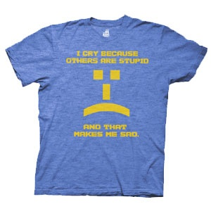 """""""I cry because others are stupid and that makes me sad"""" with a little frowny emoticon in yellow on the front of a heather blue, 90% cotton / 10% polyester t-shirt."""