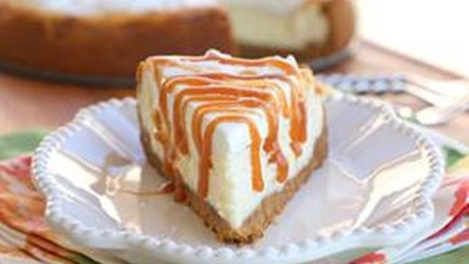 Creamy vanilla cheesecake drizzled with salted caramel.