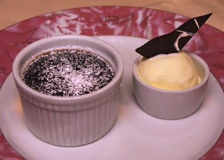 Carnival Molten Choc. Lava Cake 8 oz semi-sweet choc. 1 cup (2 sticks) butter 7 eggs, divided use 6 tblesugar 1/2 cup flour    Directions: Preheat oven to 375. Melt choc. and butter in a saucepan at low heat; cool 10 minutes. In separate bowl, mix four eggs with sugar. Whisk. Add flour and whisk. Add remaining three eggs. Add egg mixture to choc. mixture. Pour in individual ramekins. Bake until just done, about 15-20 minutes (interior will be melting).    Serve with ice cream. Makes 8 servings