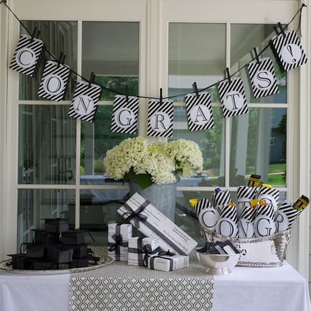 black and white congratulations banner. doubles as gift bags!