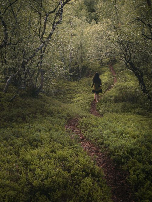 young girl walking alone in woods nude
