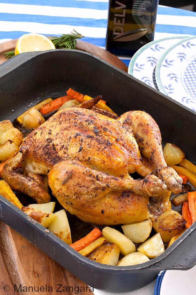 Brined chicken roasted on top of carrots, potatoes and pumpkin