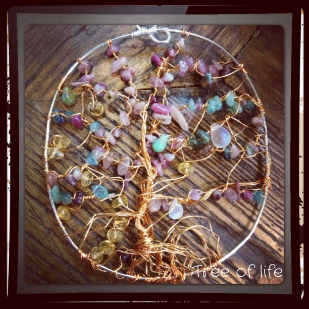 Tourmaline wire wrapped tree of life pendant.