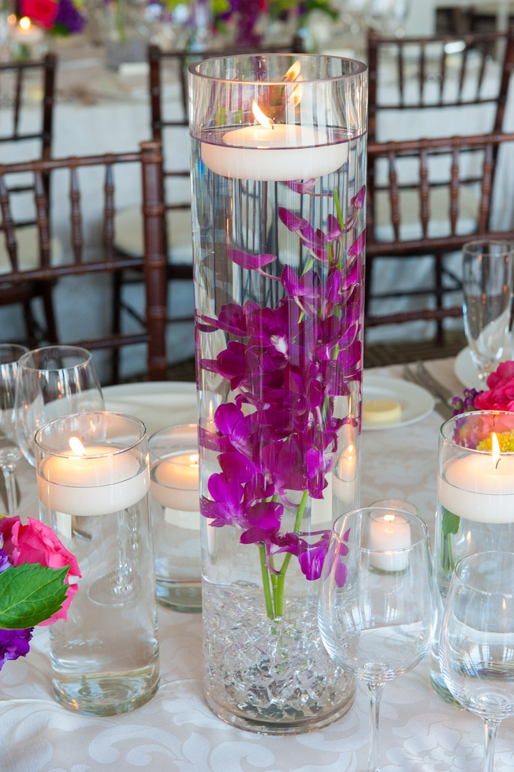 Vases with floating candles wedding pinterest for How to make flowers float in vases
