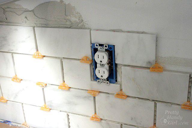 tile setting pretty handy girl
