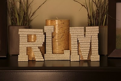 I love these letters made out of tiny rolled pages of books... I am always looking for fun ways to cover chip board letters!