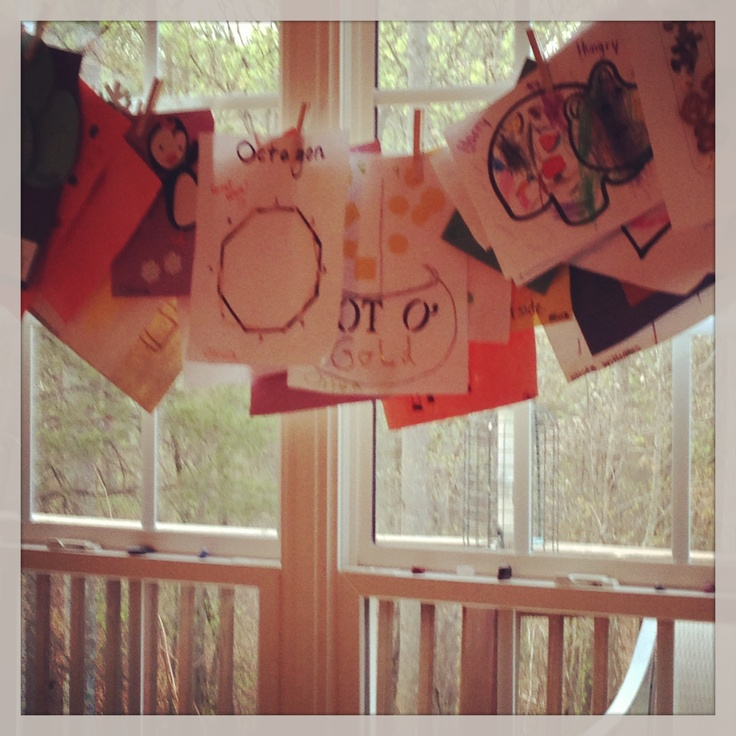 love decorating. To hang Olivia's artwork take some twine from the