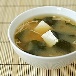 Miso soup with tofu, wakame, and enoki mushrooms.