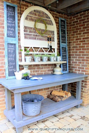 Old garage work bench turned darling potting table.