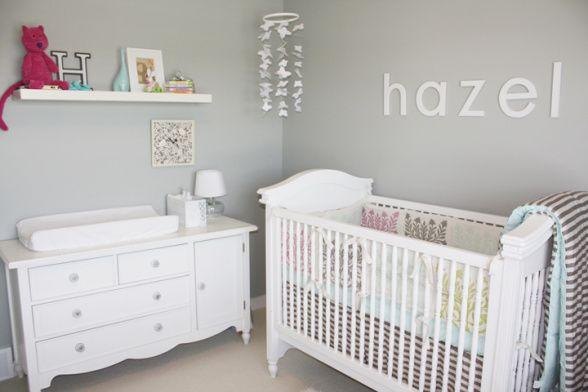 White crib against a gray wall