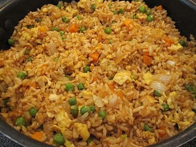 Easy fried rice, better than takeout!  3 cups cooked white rice.  3 tbs sesame oil  1 cup frozen peas and carrots (thawed)  1 small onion, chopped  2 tsp minced garlic  2 eggs, slightly beaten  1/4 cup soy sauce.