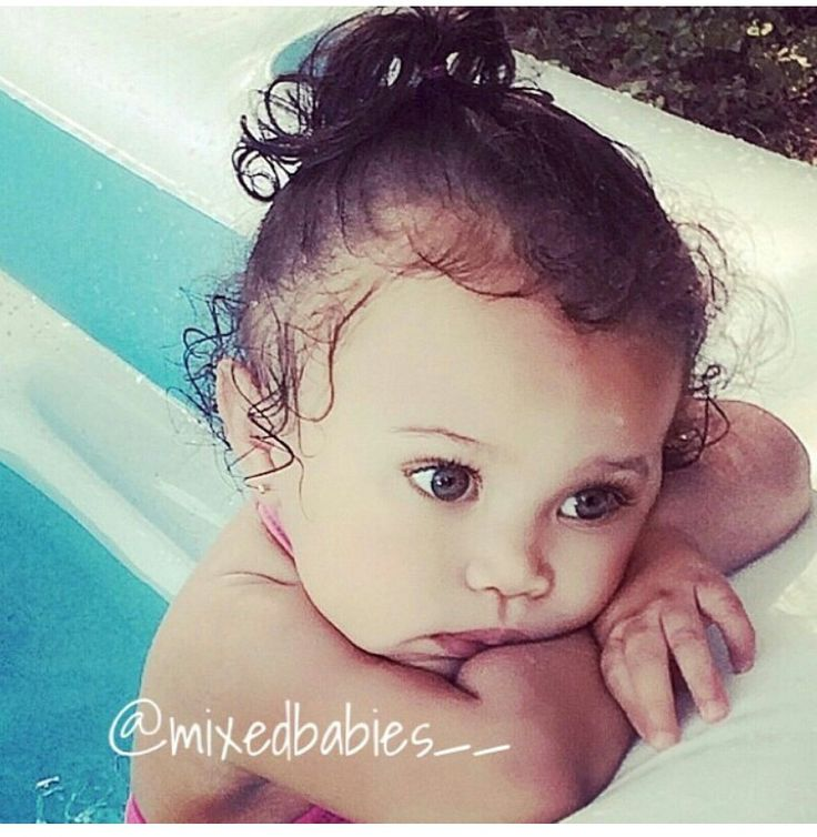 Cute mixed baby with curly