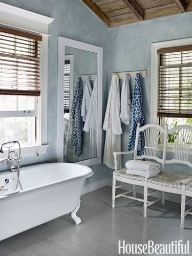 The master bathroom walls are painted a custom faded teal.