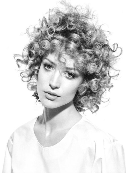 get these curls with sponge rollers... shoulder length hair w/bangs... roll from the top down not the bottom up so your curls start at your roots...