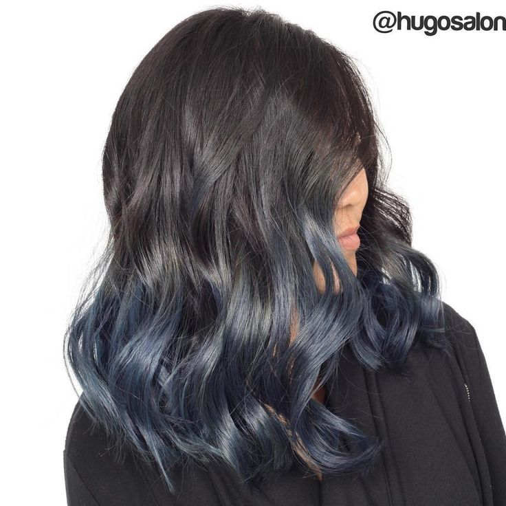 Black hair with teal tips
